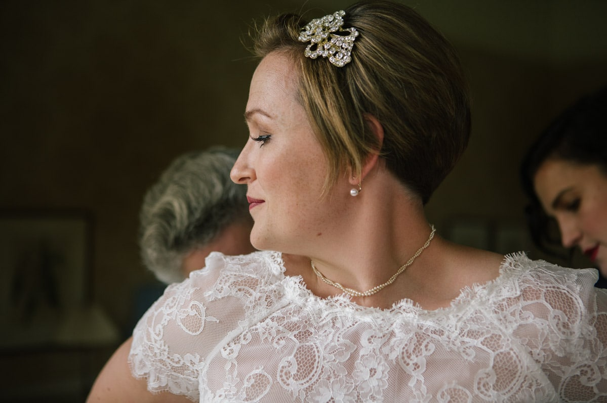 A close up bridal portrait showing the lace detailing on Julia's dress, and her vintage style hair comb