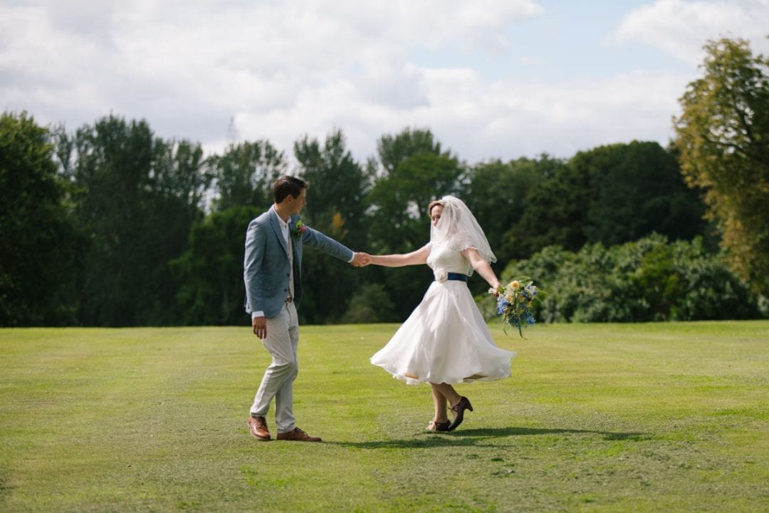 bride and groom dancing before their wedding ceremoy in the garden of Baldon House