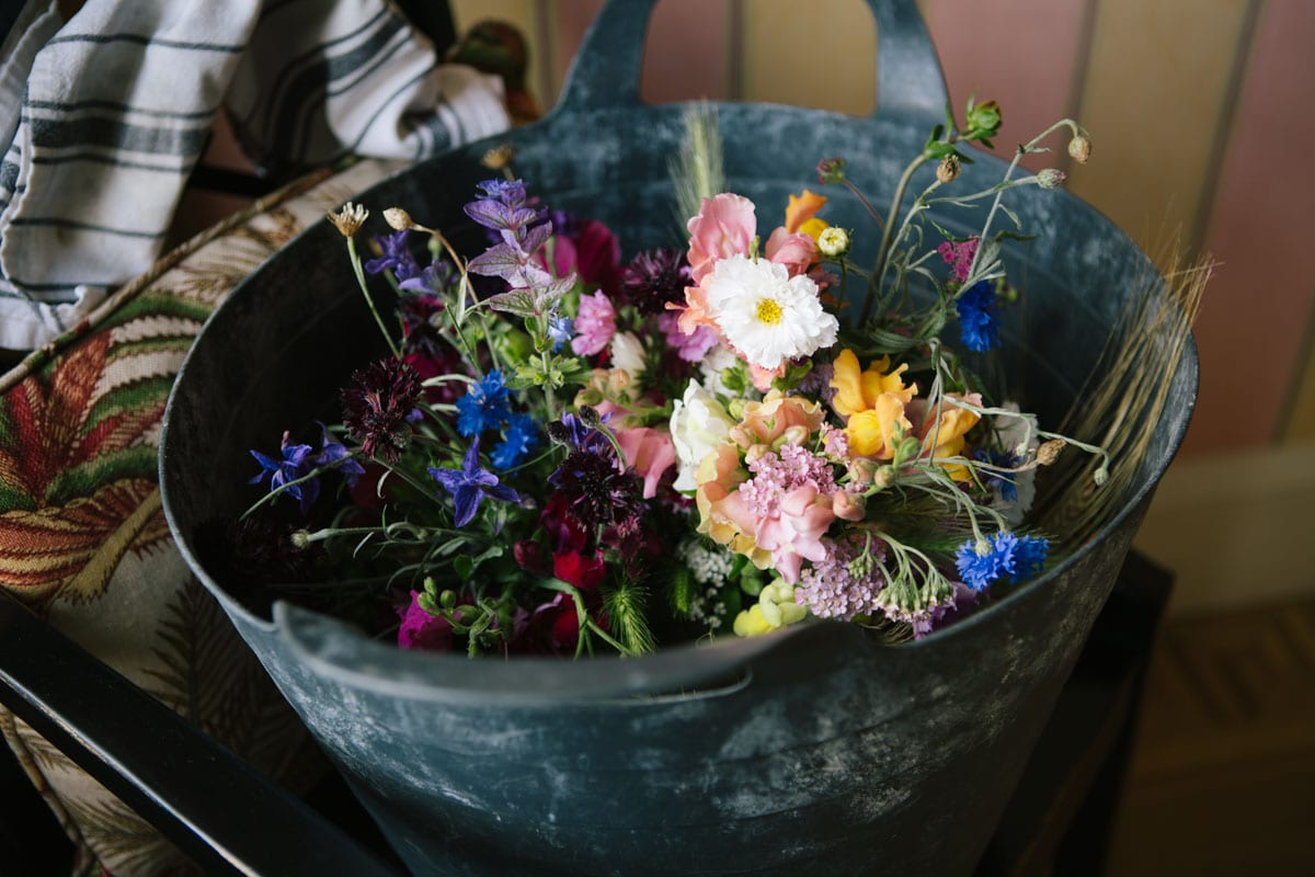 The bouquets are placed in a large bucket for safe keeping