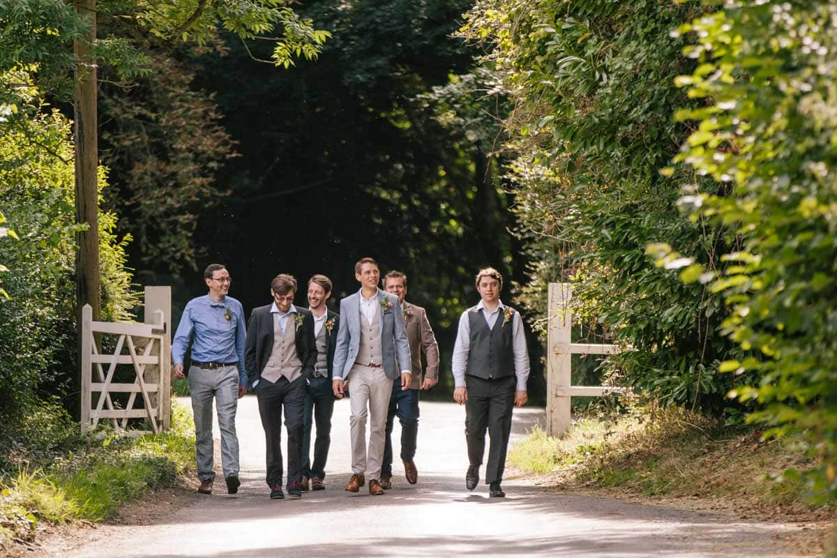 The groom walks from Baldon House to the Seven Stars, accompanied by his groomsmen and ushers