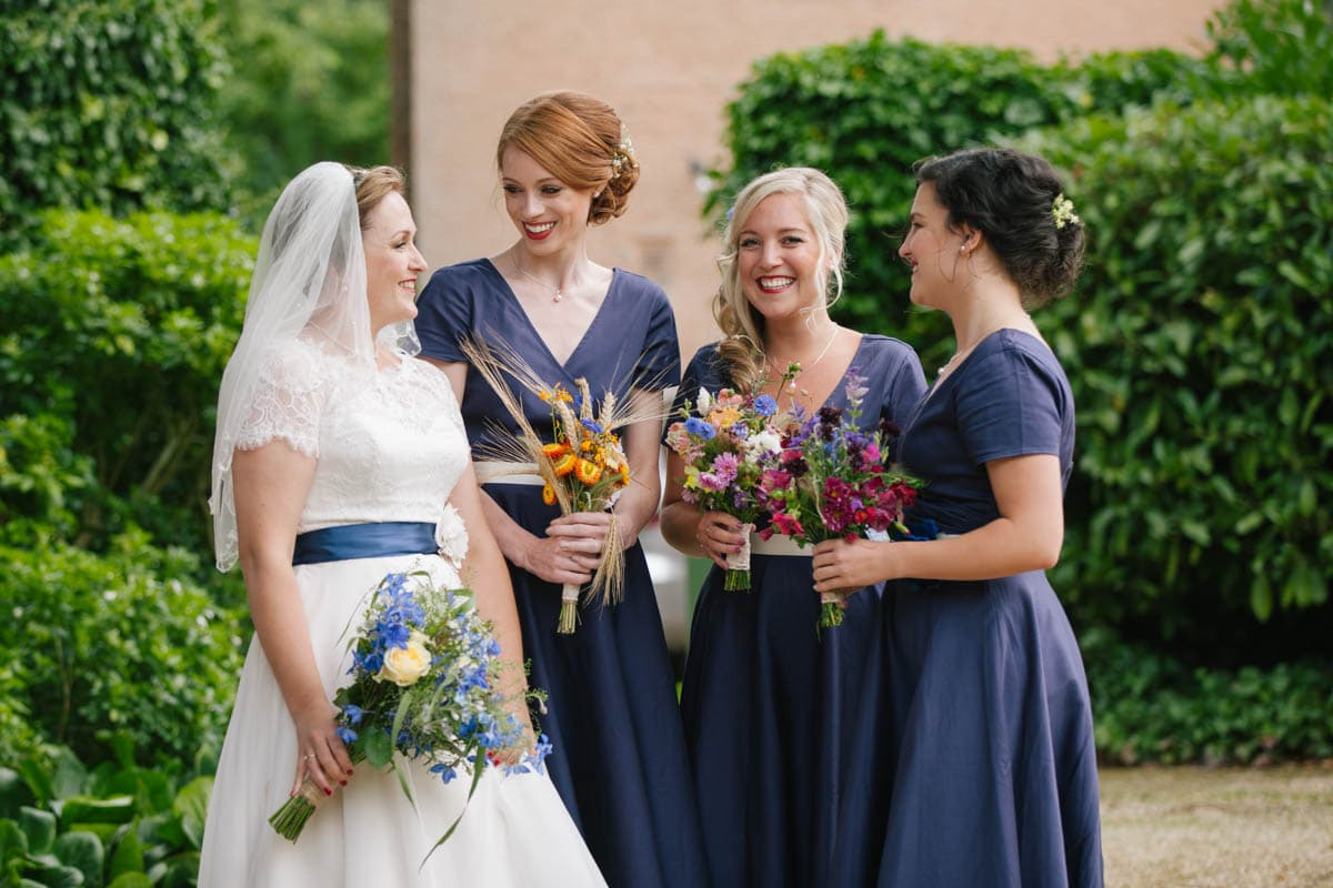 The bride chats with her three bridesmaids