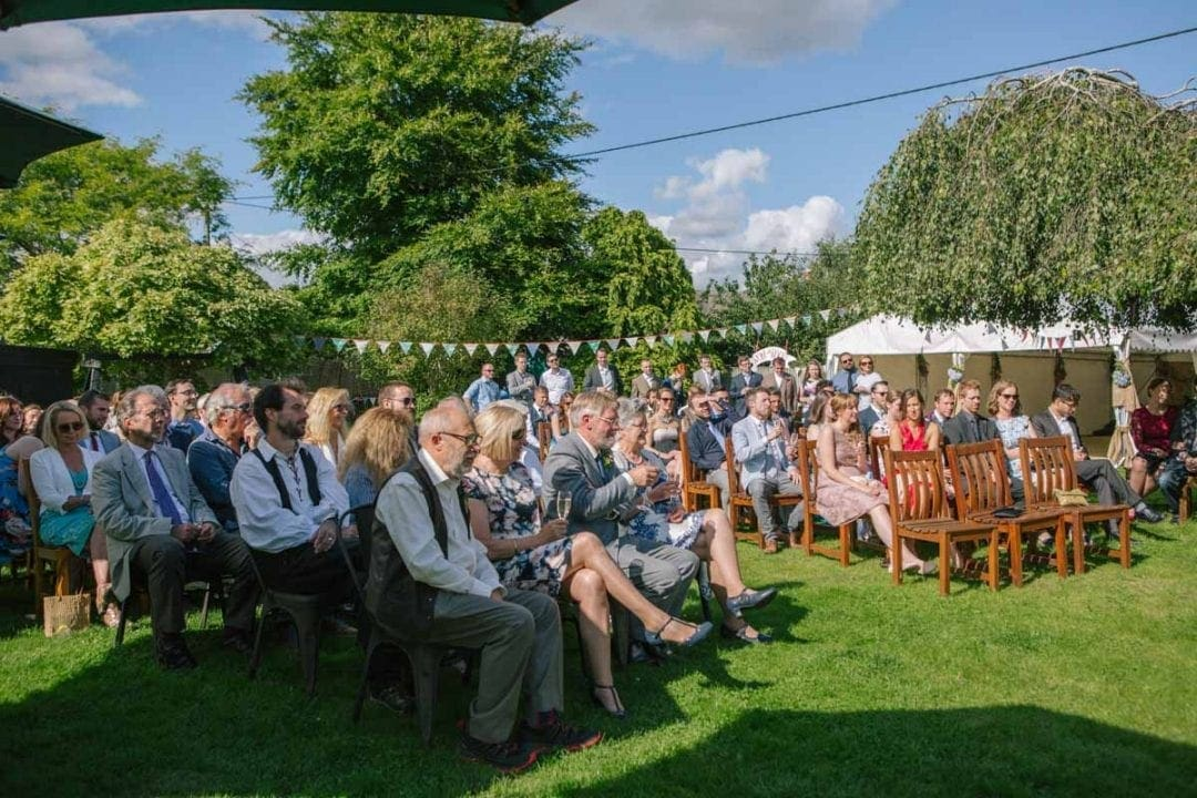 Guests seated at an outdoor garden wedding in Oxfordshire