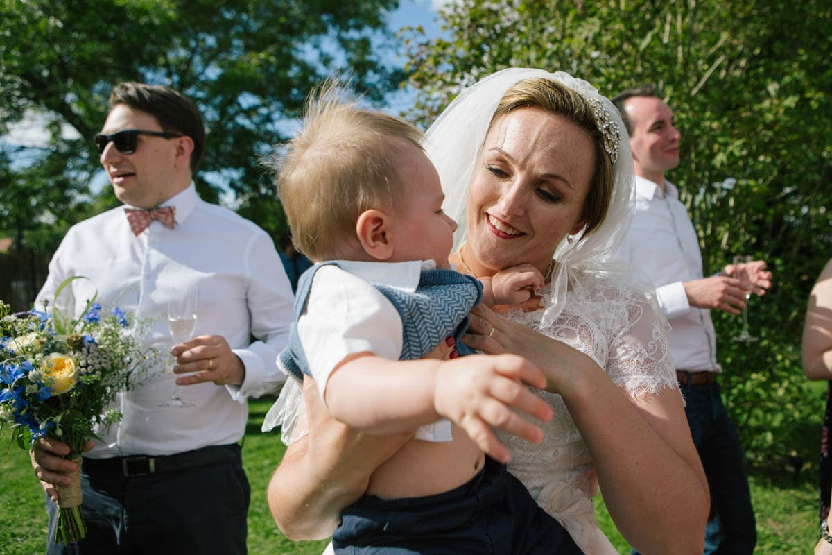 The bride cuddles a baby guest