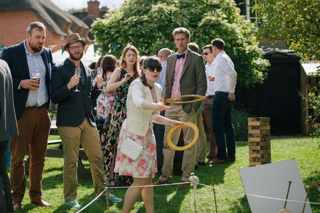 Guests playing lawn games at an Oxford wedding