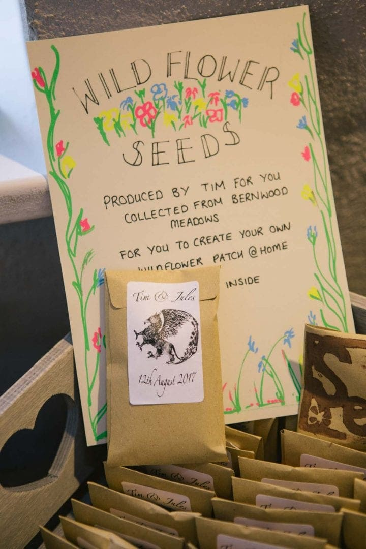 Hand drawn sign for wildflower seeds at a garden wedding in Oxford