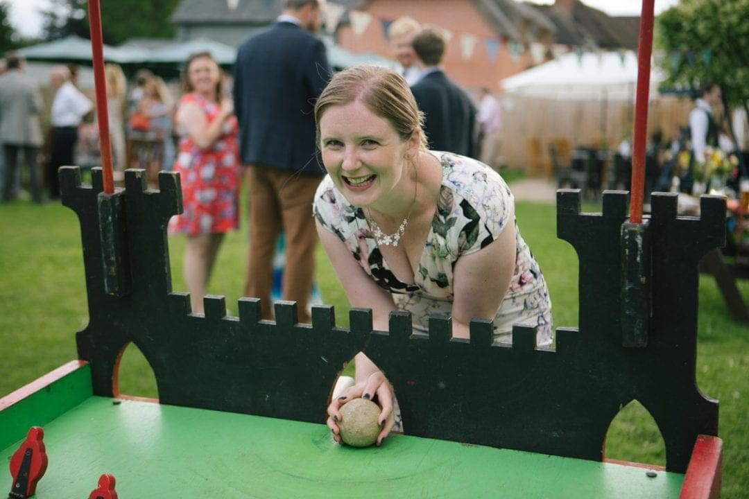 Happy guest playing lawn games at an Oxford garden wedding