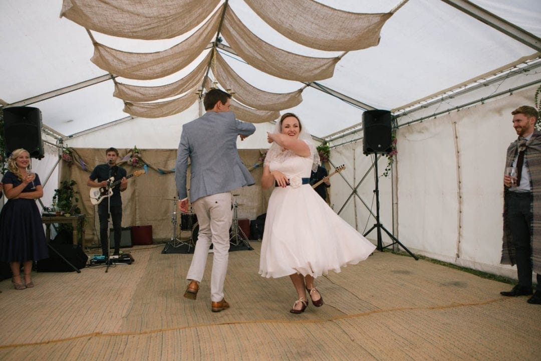 Bride and groom first dance in a marquee