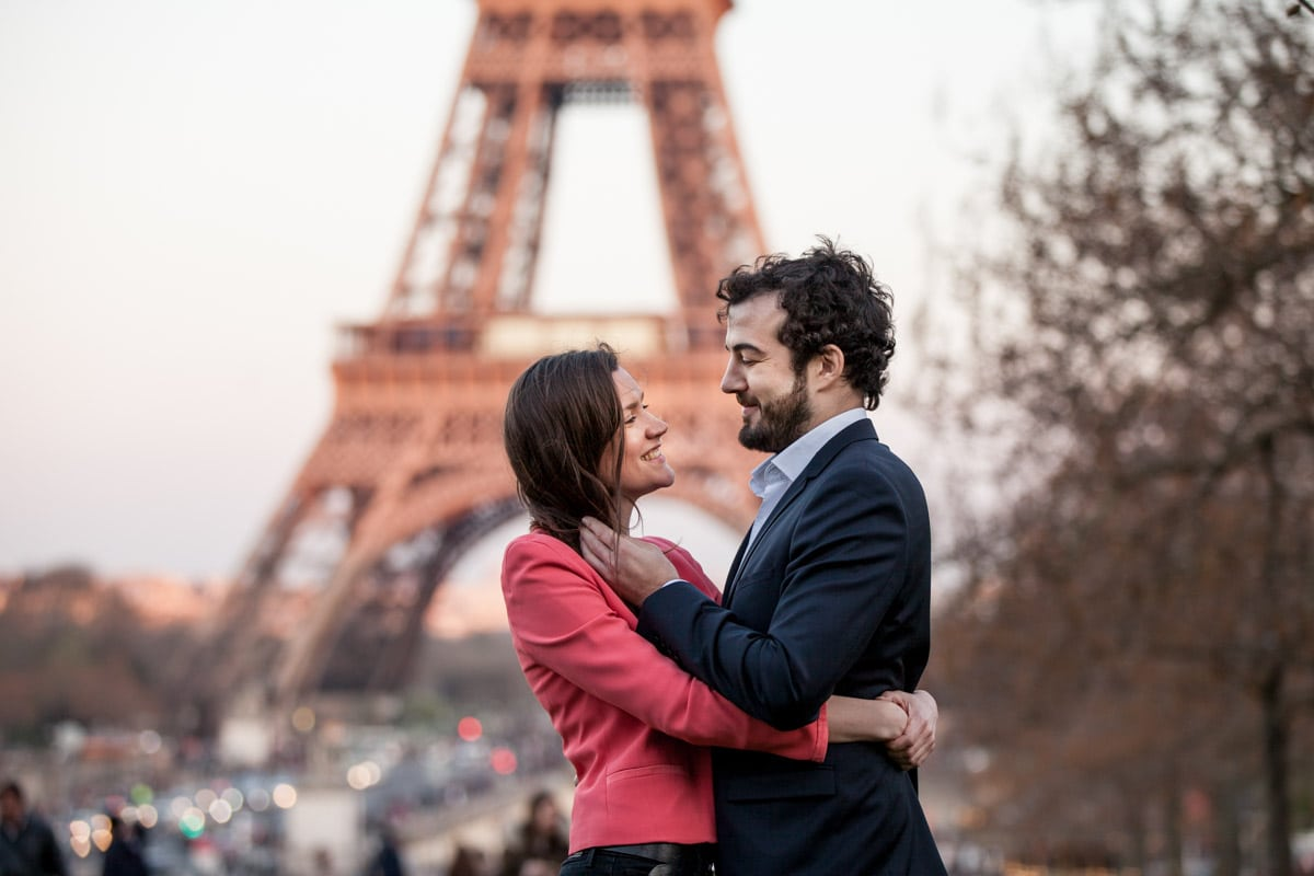 couple staring into each others eyes in front of the Eiffell Tower