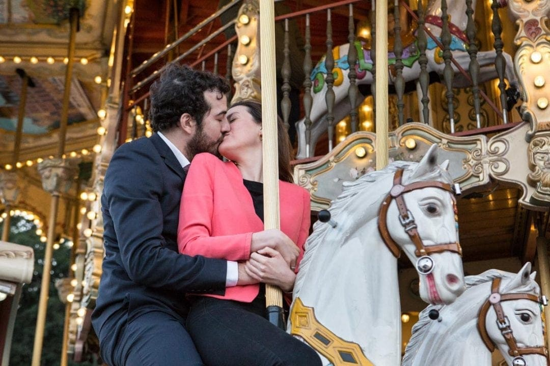 Engagement photoshoot on a merry go round in Paris