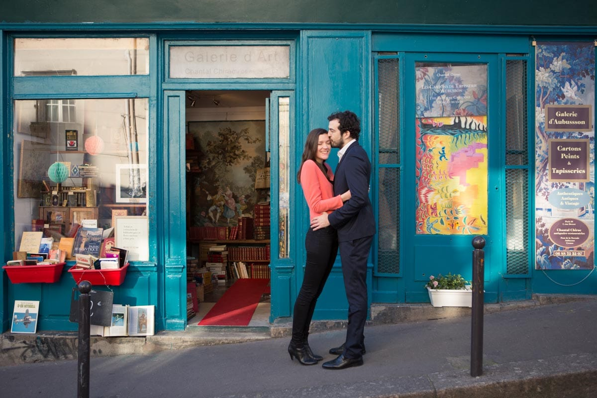Couple huging in front of a Bohemian bookstore in Paris