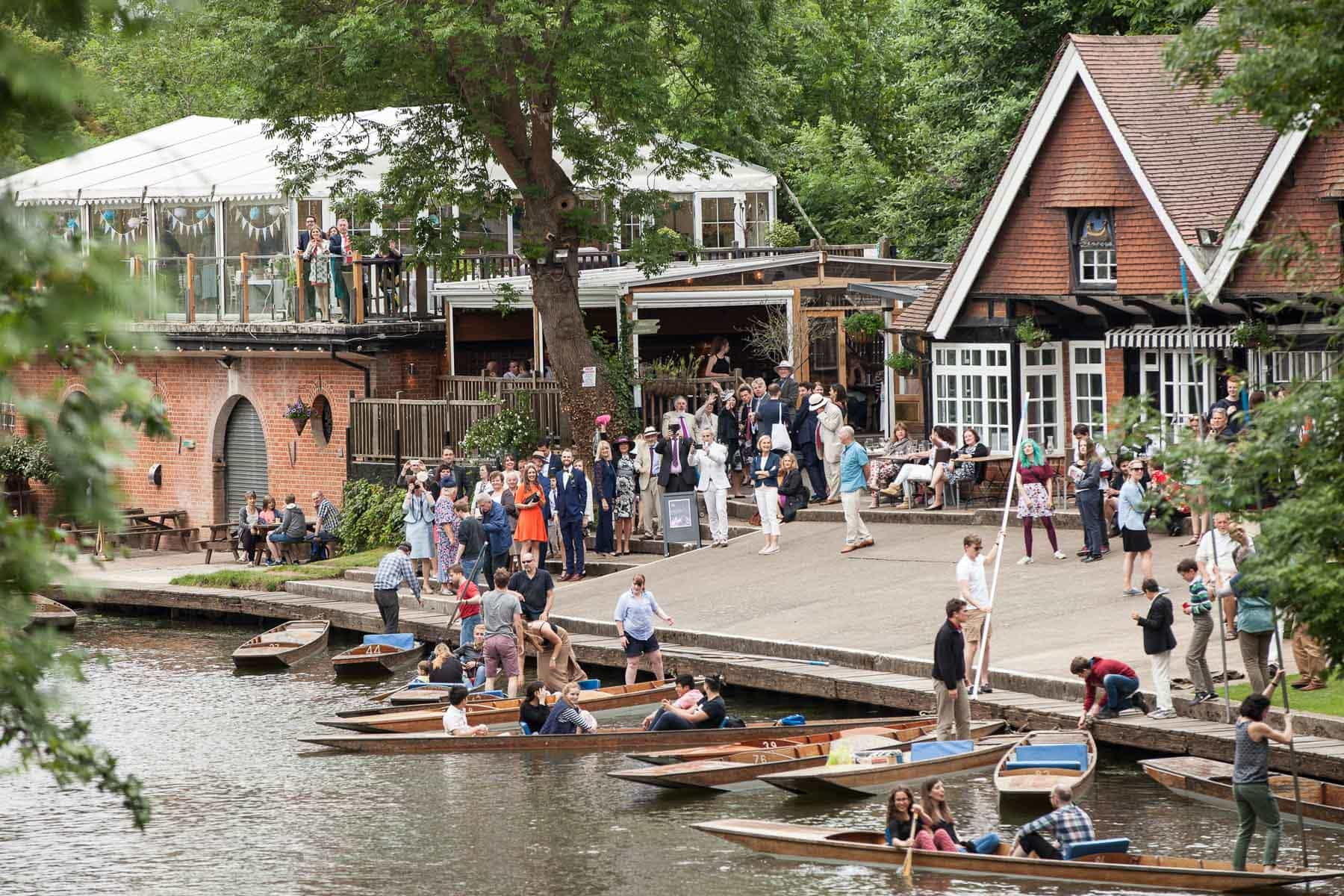 Guests arrive at the Cherwell Boathouse by punt