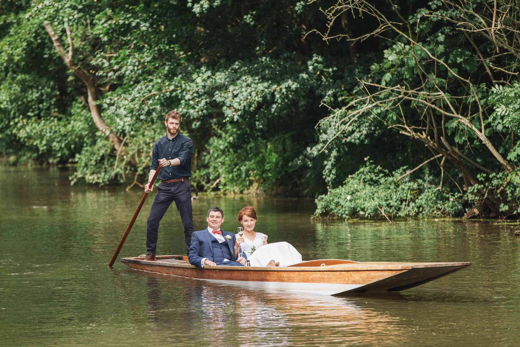 Bride and groom arrive at the venue by punt