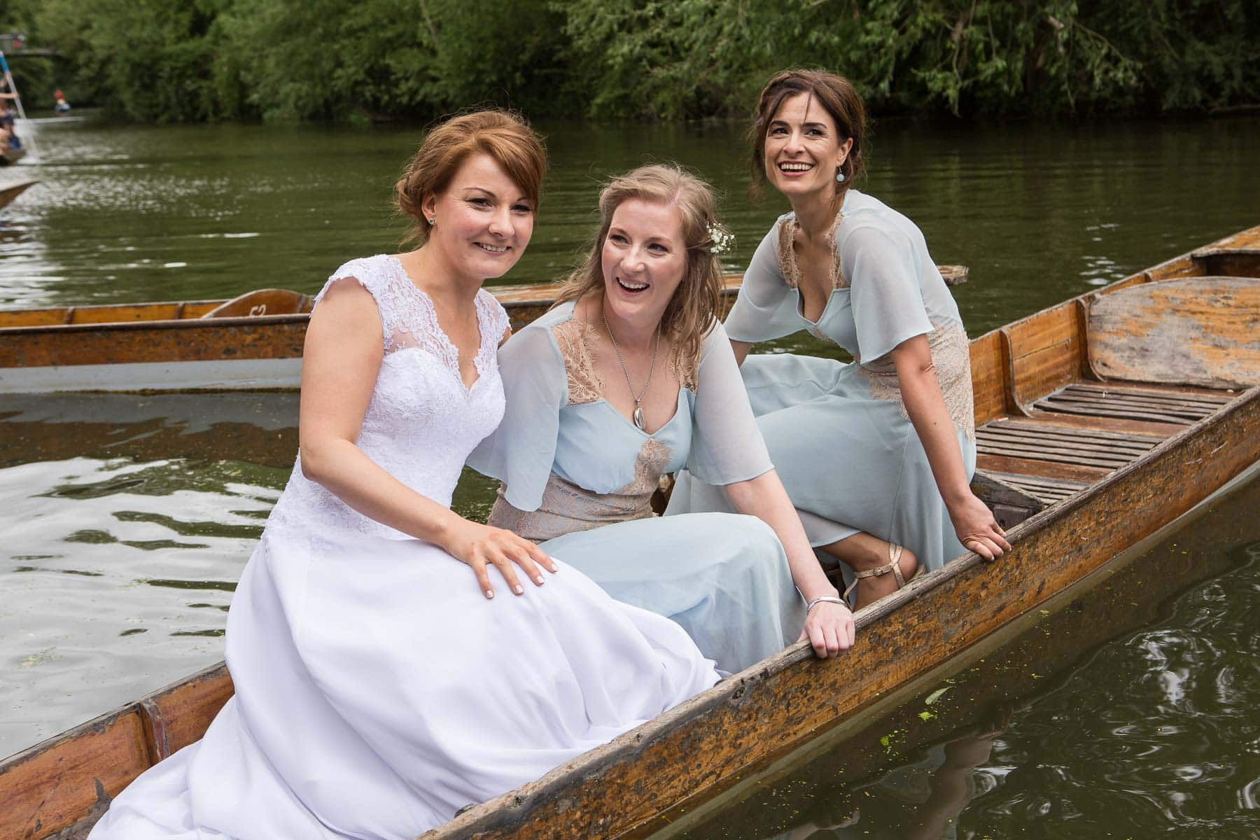 Bride and bridesmaids together in punt on the River Cherwell
