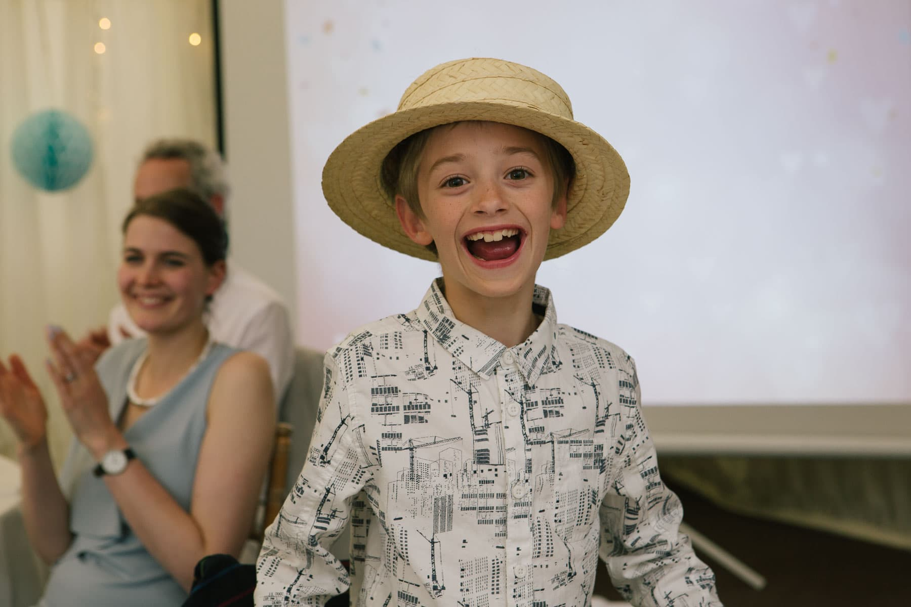 A young guest looking cool in a straw boater