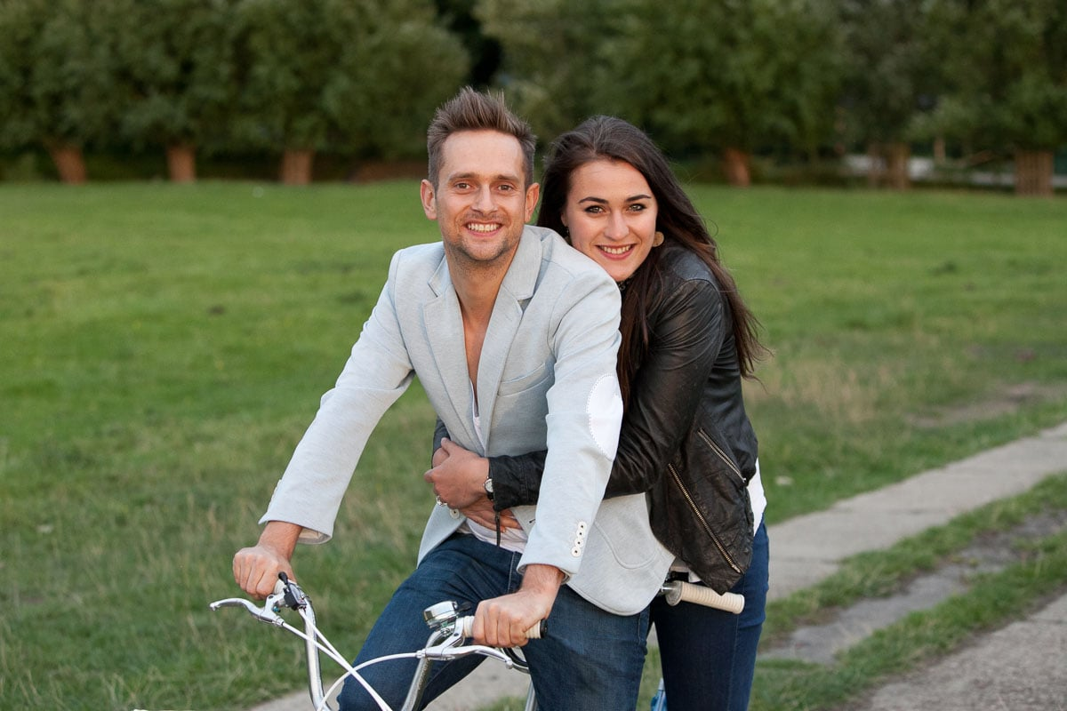 Couple embrace while sitting on a tandem