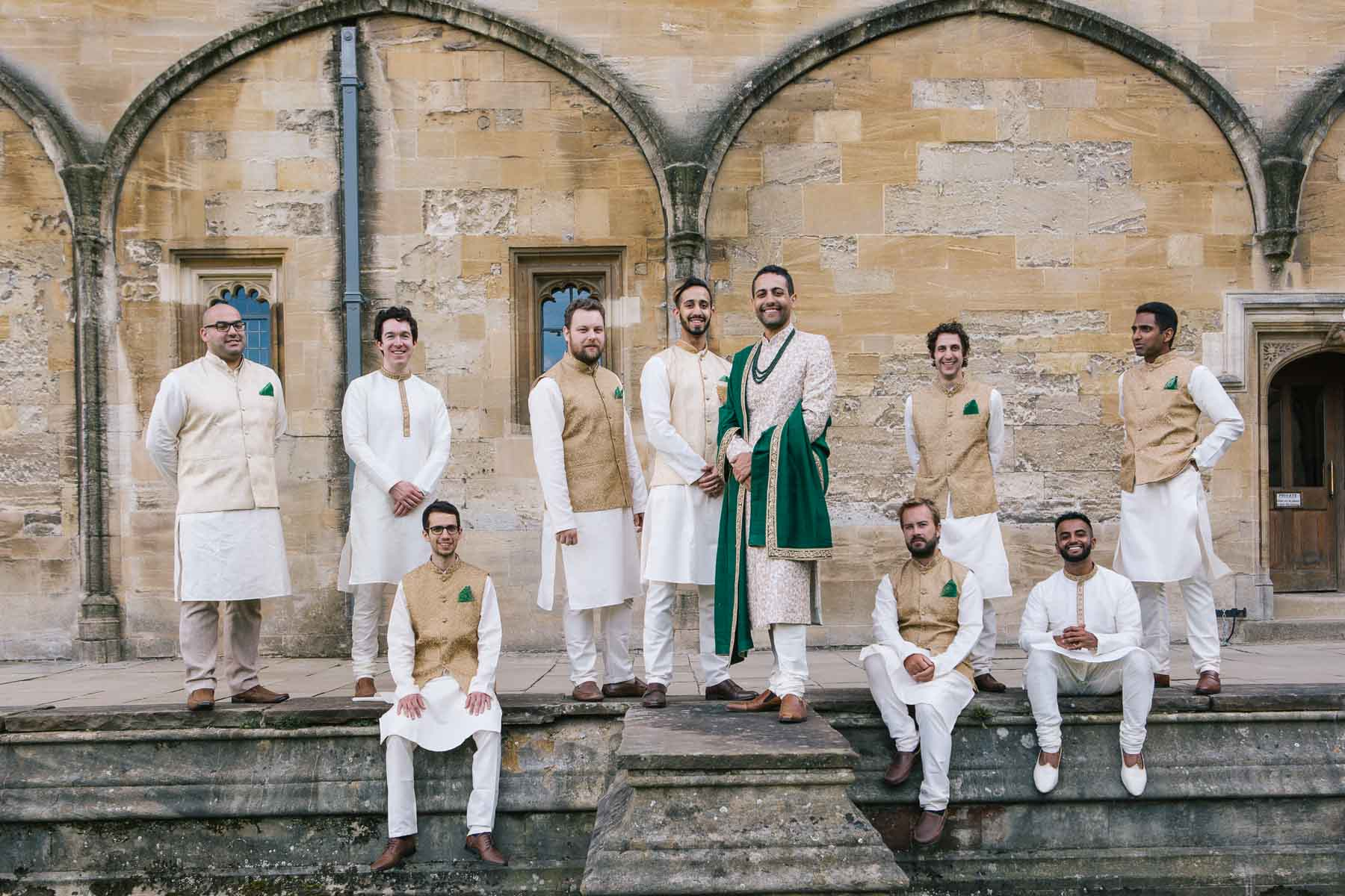 Groom and groomsmen on steps of Christchurch college