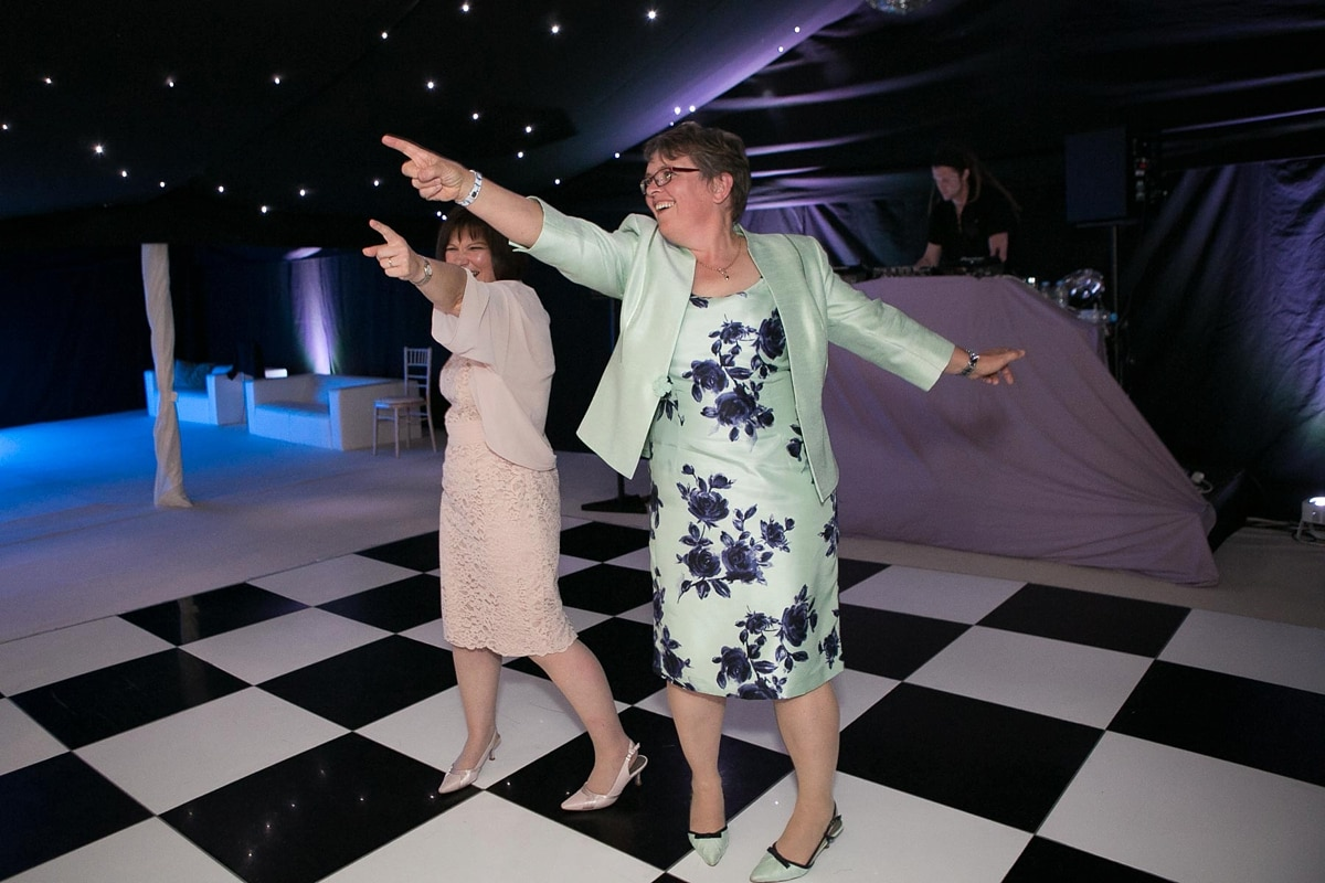 Older lesbian couple show off their moves on the dancefloor