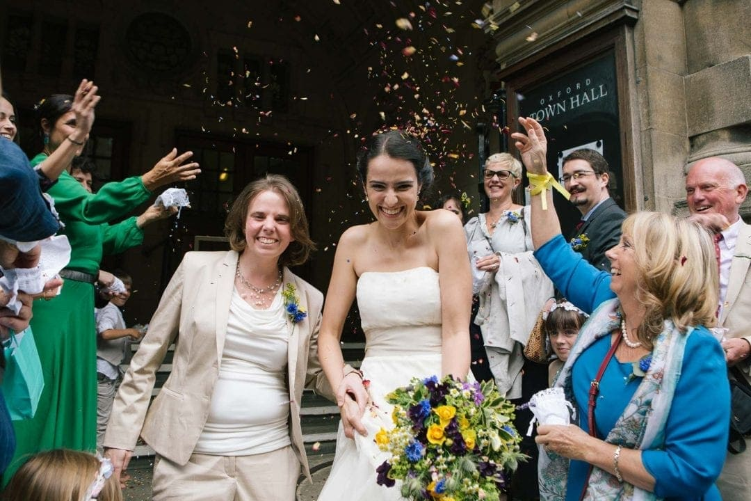 Lesbian brides leave Oxford town hall in a shower of confetti