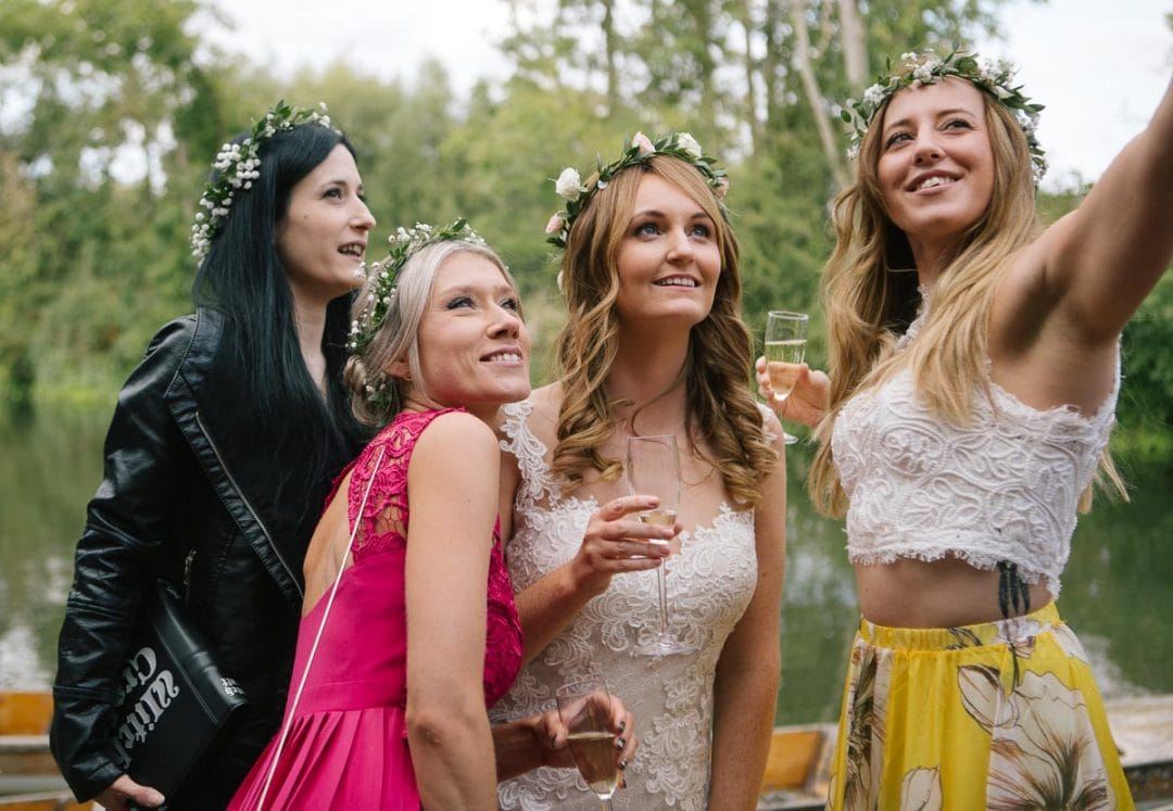 bride and bridesmaids pose for a selfie