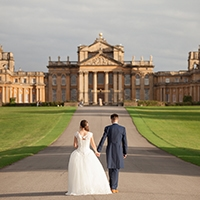 wedding couple walking in front of Blenheim Palace