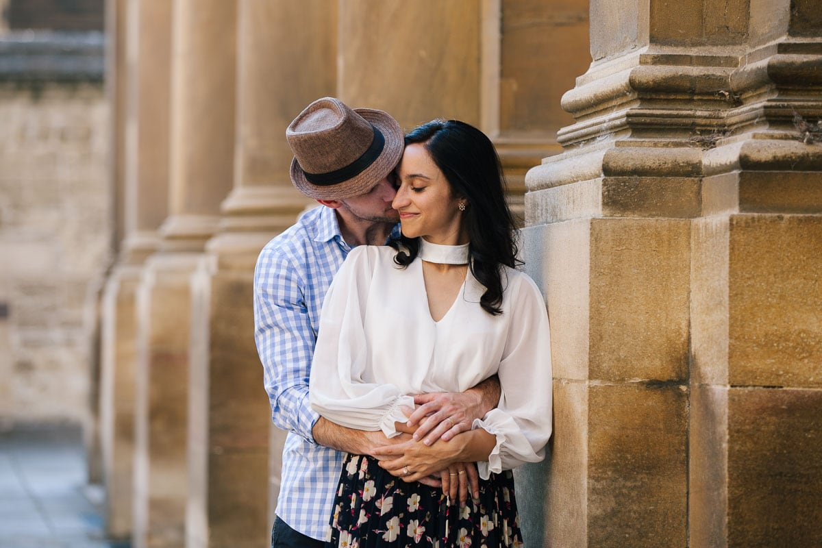 A romantic shot of a couple in front of the Bodleian Library in Oxford