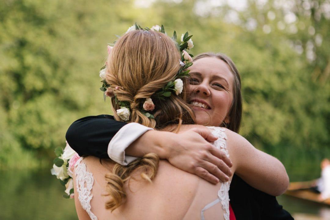 Friend hugs bride