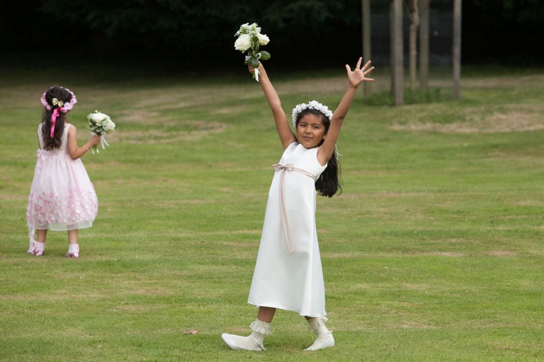 Flower girl in white with flowers